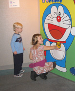 (photo) children with poster of Doraemon